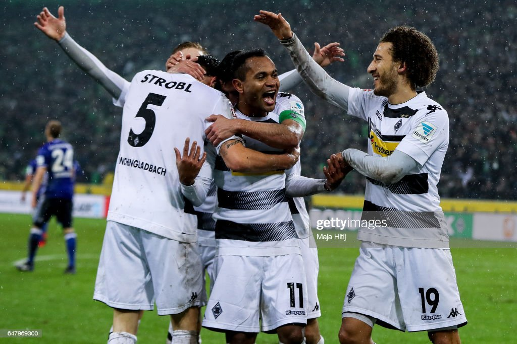 Raffael of Moenchengladbach (C) celebrates with his team-mates after scoring his team's forth goal to make it 4-1 during the Bundesliga match between Borussia Moenchengladbach and FC Schalke 04 at Borussia-Park on March 4, 2017 in Moenchengladbach, Germany.