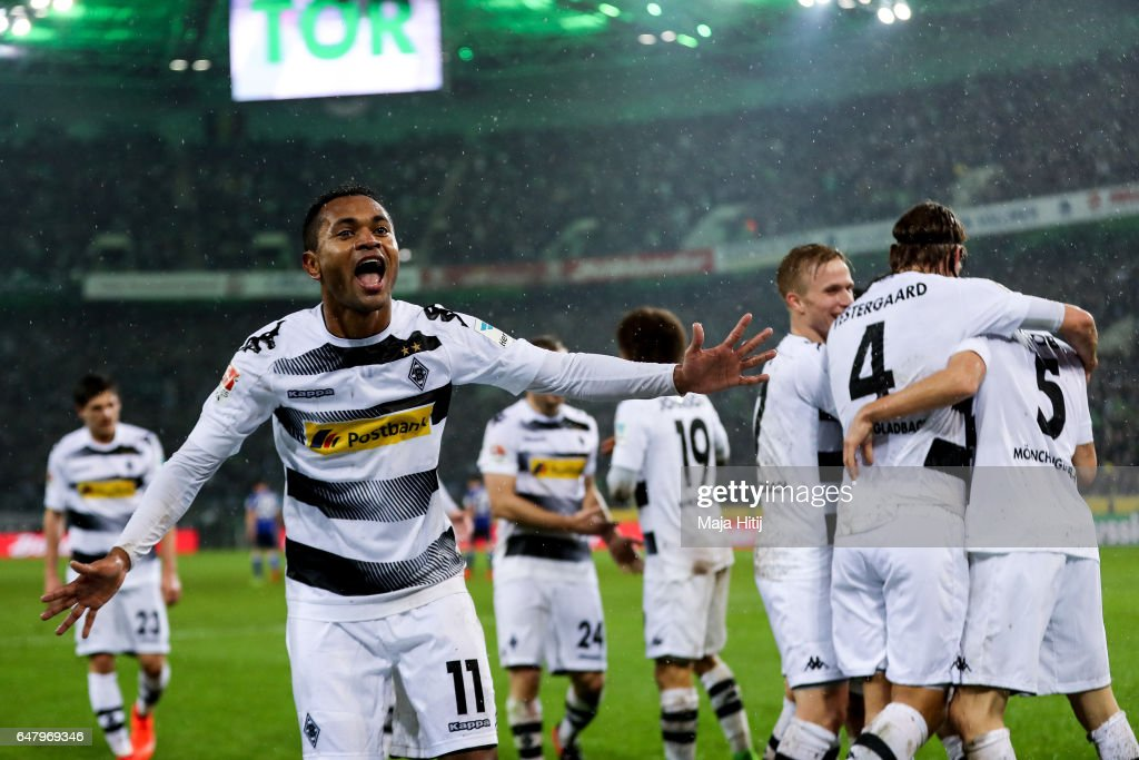 Raffael of Moenchengladbach (L) celebrates with his team-mates after scoring his team's forth goal to make it 4-1 during the Bundesliga match between Borussia Moenchengladbach and FC Schalke 04 at Borussia-Park on March 4, 2017 in Moenchengladbach, Germany.