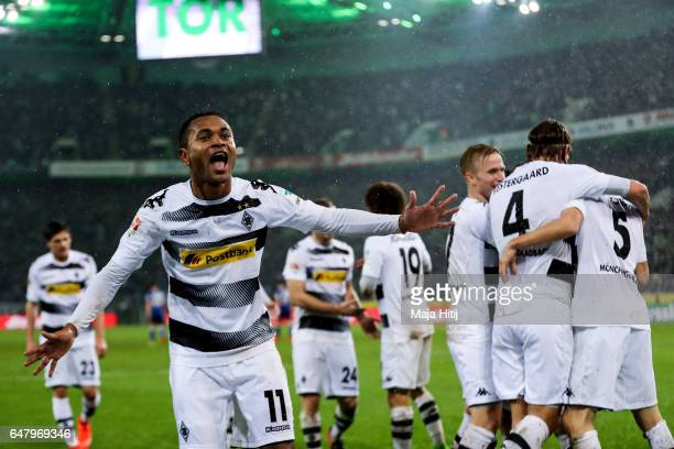 Raffael of Moenchengladbach celebrates with his teammates after scoring his team's forth goal to make it 41 during the Bundesliga match between...