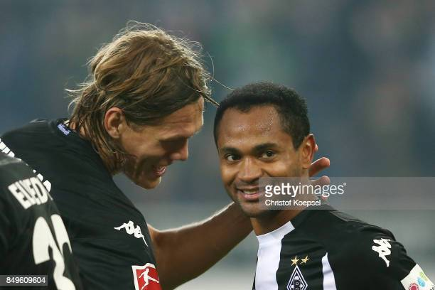 Raffael of Moenchengladbach celebrates with Jannik Vestergaard of Moenchengladbach after he scored a penalty goal to make it 20 during the Bundesliga...