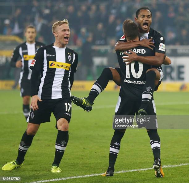 Raffael of Moenchengladbach celebrates with Thorgan Hazard of Moenchengladbach after he scored a penalty goal to make it 20 during the Bundesliga...