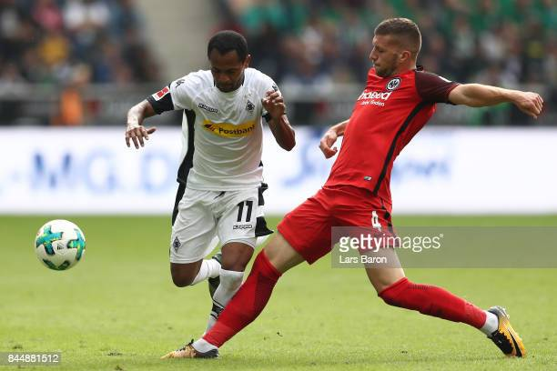 Raffael of Moenchengladbach fights for the ball with Ante Rebic of Frankfurt during the Bundesliga match between Borussia Moenchengladbach and...