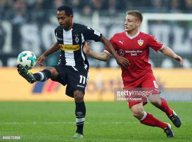 Raffael of Moenchengladbach fights for the ball with Santiago Ascacibar of Stuttgart during the Bundesliga match between Borussia Moenchengladbach...