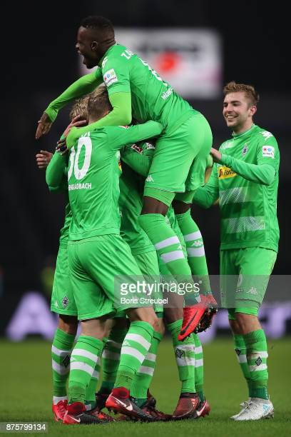 Raffael of Moenchengladbach is celebrated by his team after he scored a goal to make it 30 during the Bundesliga match between Hertha BSC and...