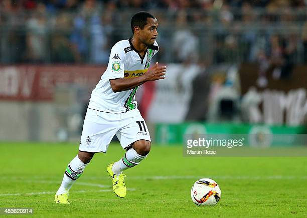 Raffael of Moenchengladbach runs with the ball during the DFB Cup First Round match between FC StPauli and Borussia Moenchengladbach at Millerntor...