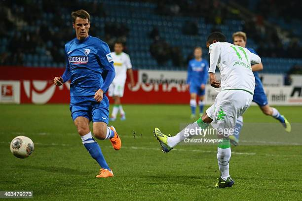 Raffael of Moenchengladbach scores the first goal against Jonas Acquistapace of Bochum during the friendly match between VfL Bochum and Borussia...