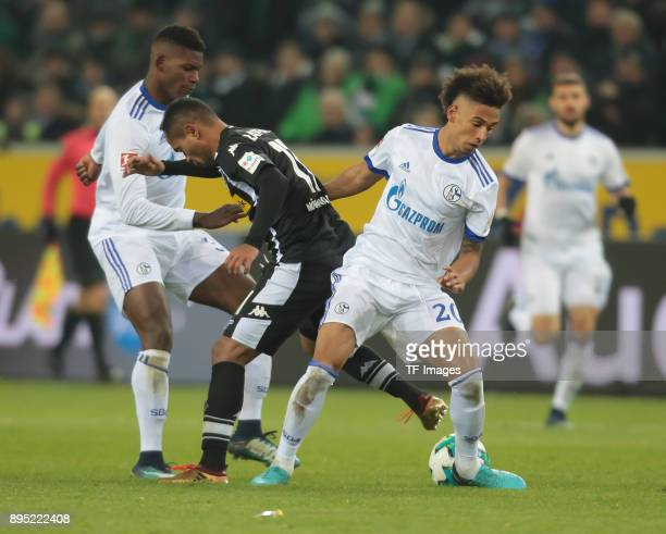 Raffael of Moenchengladbach Thilo Kehrer of Schalke and Breel Embolo battle for the ball during the Bundesliga match between Borussia...