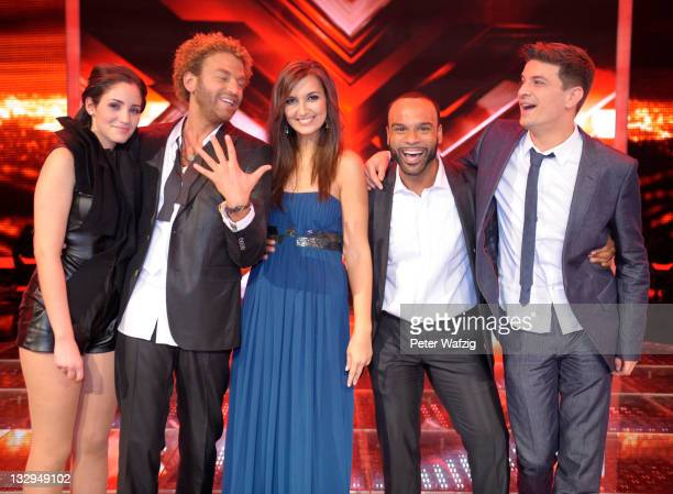 Raffaela Wais Rufus Martin Nica Joe and David Pfeffer during the winners photocall at the 'The X Factor Live' TVShow on November 15 2011 in Cologne...
