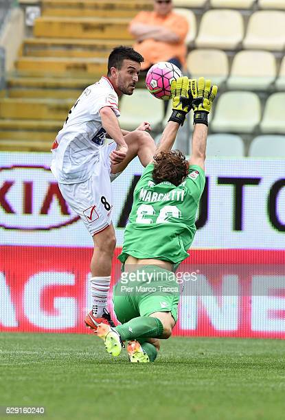 Raffaele Bianco of Carpi FC competes for the ball with SS Lazio goalkeeper Federico Marchetti in action during the Serie A match between Carpi FC and...