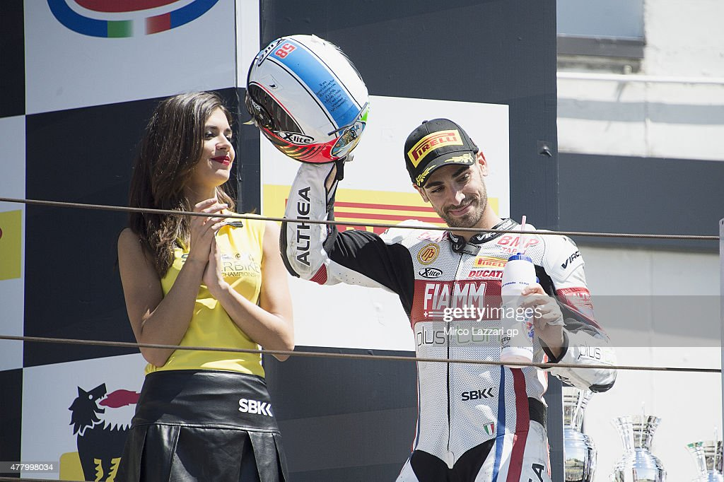 Raffaele De Rosa of Italy and Althea Racing celebrates the second place on the podium at the end of the Superstock 1000 Race during the FIM Superbike World Championship - Race at Misano World Circuit on June 21, 2015 in Misano Adriatico, Italy.