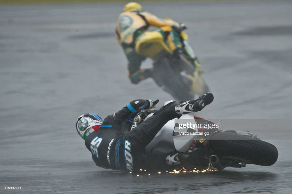 Raffaele De Rosa of Italy and SAG Team crashes out during the Moto2 race of MotoGp Of Great Britain at Silverstone Circuit on June 12, 2011 in Northampton, England.