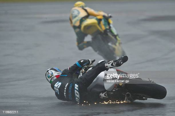 Raffaele De Rosa of Italy and SAG Team crashes out during the Moto2 race of MotoGp Of Great Britain at Silverstone Circuit on June 12, 2011 in...