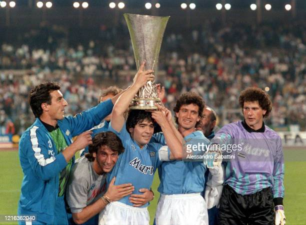 Raffaele Di Fusco,Massimo Crippa, Diego Armando Maradona, Francesco Romano and Giuliano Giuliani of SSC Napoli celebrate his victory with the trophy...