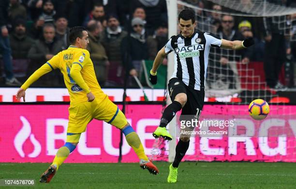 Raffaele Maiello of Frosinone Calcio competes for the ball with Kevin Lasagna of Udinese Calcio during the Serie A match between Udinese and...