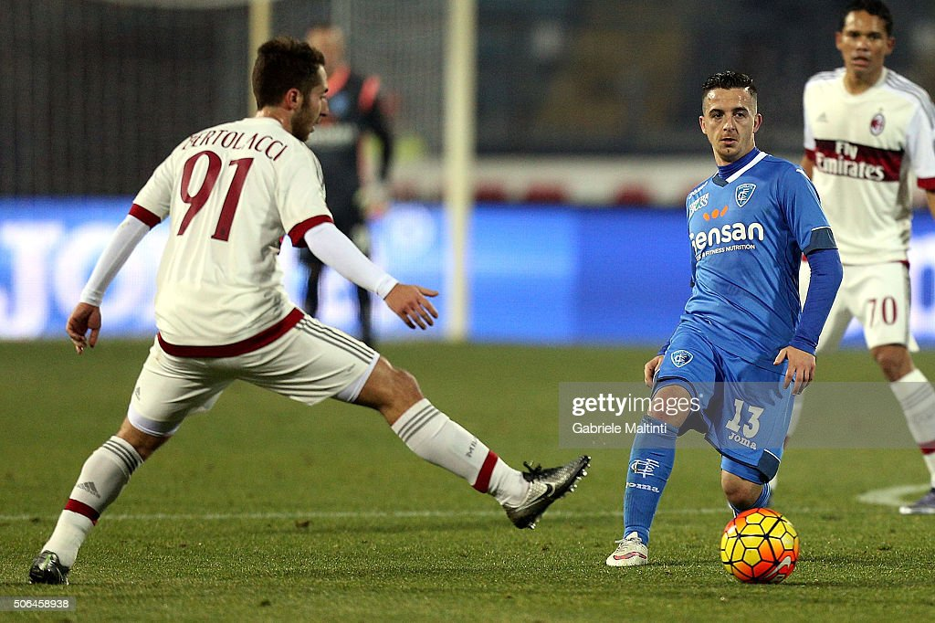 Raffaele Masiello of Empoli FC battles for the ball with Andrea Bertolacci of AC Milan during the Serie A match between Empoli FC and AC Milan at Stadio Carlo Castellani on January 23, 2016 in Empoli, Italy.