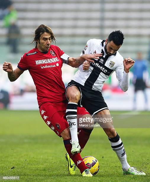Raffaele Palladino of Parma FC competes for the ball with Daniele Conti of Cagliari Calcio during the Serie A match between Parma FC and Cagliari...