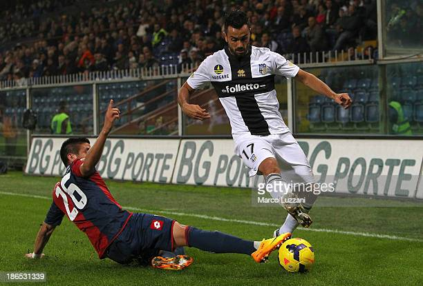 Raffaele Palladino of Parma FC competes for the ball with Ricardo Centurion of Genoa CFC during the Serie A match between Genoa CFC and Parma FC at...