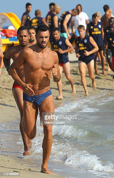 Raffaele Palladino of Parma FC trains on the shore during a Parma FC PreSeason Training Session at Rosa Marina Resort on July 8 2013 in Ostuni Italy