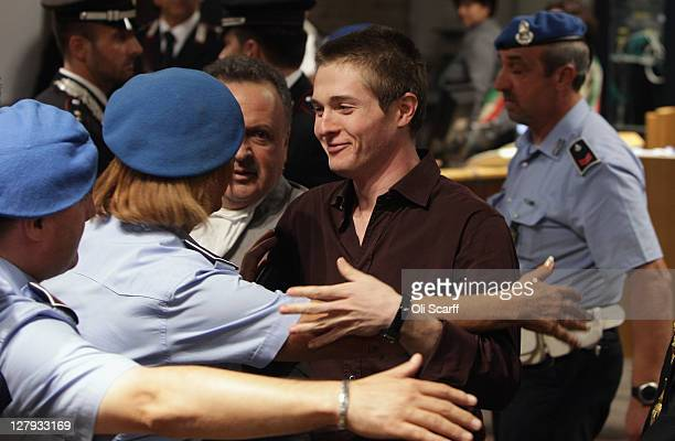 Raffaele Sollecito is congratulated in Perugia's Court of Appeal after hearing that he won his appeal against his murder conviction on October 3,...