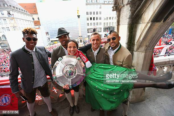 Raffaella Manieri of Bayern Muenchen Womans team celebrates winning the German Championship title with David Alaba Douglas Costa Rafinha and Arturo...