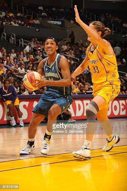 Raffaella Masciadri of the Los Angeles Sparks guards as Candice Wiggins of the Minnesota Lynx goes up for a shot during the game on July 3 2008 at...