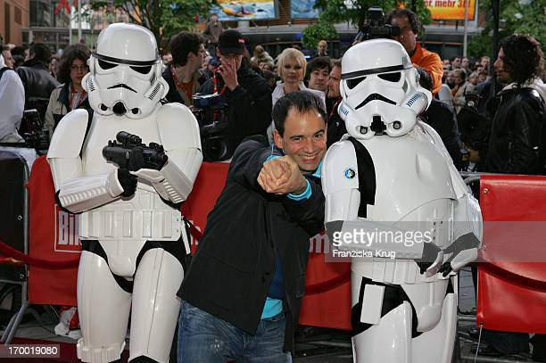 Raffaello Kramm With Stormtroopers In The Germany premiere of Star Wars Episode Iii Revenge of the Sith In the theater at Potsdamer Platz in Berlin