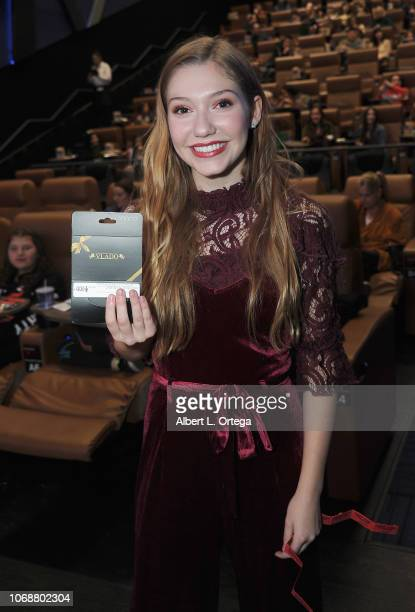 Raffel winner Jamie Timmons at the Hunter Payton And The Shoe Crew Holiday Charity Fundraiser Screening of Illumination's 'The Grinch' Benefiting The...