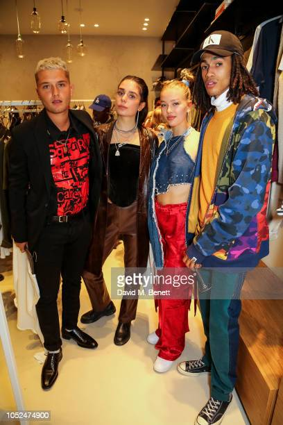 Rafferty Law guest Jessica Alexander and Kelvin Bueno attend the American Vintage store opening in Marylebone on October 18 2018 in London England