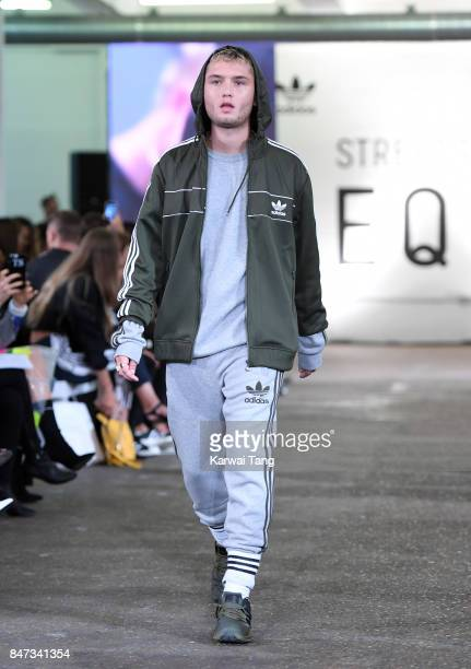 Rafferty Law walks the runway of the Streets of EQT Fashion Show at The Old Truman Brewery on September 15 2017 in London England Hailey Baldwin...