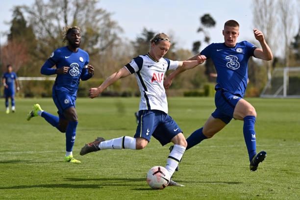 Rafferty Pedder of Tottenham Hotspur shoots under pressure from Sam Mcclelland of Chelsea during the Premier League 2 match between Tottenham Hotspur...