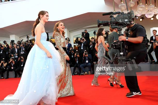 Raffey Cassidy and Natalie Portman walk the red carpet ahead of the 'Vox Lux' screening during the 75th Venice Film Festival at Sala Grande on...