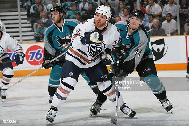 Raffi Torres of the Edmonton Oilers battles for position with Christian Ehrhoff of the San Jose Sharks during Game 2 of the Western Conference...
