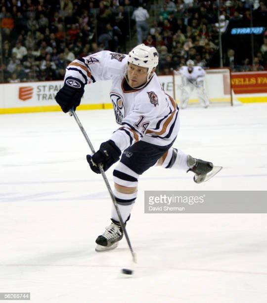Raffi Torres of the Edmonton Oilers shoots the puck against of the Minnesota Wild on November 23, 2005 at the Xcel Energy Center in St. Paul,...