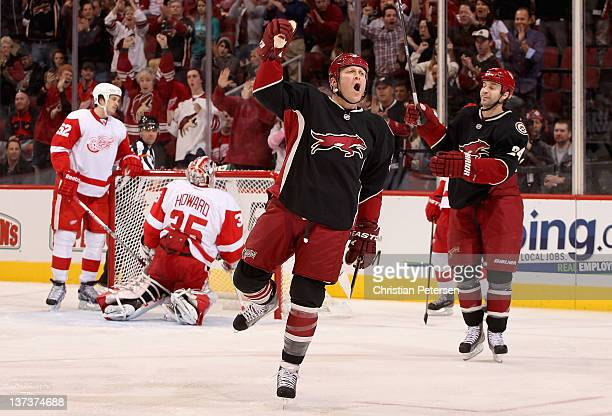 Raffi Torres of the Phoenix Coyotes celebrates after scoring a first period goal against goaltender Jimmy Howard of the Detroit Red Wings during the...