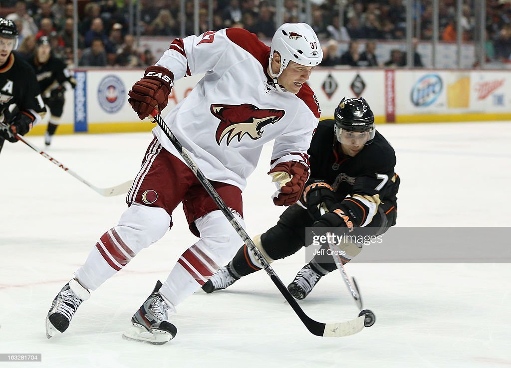 Raffi Torres #37 of the Phoenix Coyotes is pursued by Andrew Cogliano #7 of the Anaheim Ducks for the puck in the third period at Honda Center on March 6, 2013 in Anaheim, California. The Ducks defeated the Coyotes 2-0.