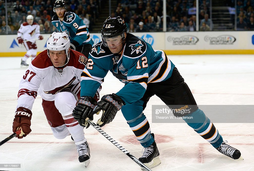Raffi Torres #37 of the Phoenix Coyotes race to gain control of the puck against Patrick Marleau #12 of the San Jose Sharks in the first period at HP Pavilion on February 9, 2013 in San Jose, California.
