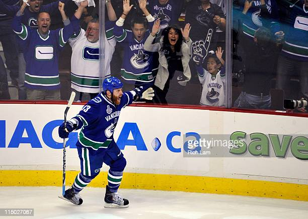 Raffi Torres of the Vancouver Canucks celebrates after scoring a goal late in the third period against Tim Thomas of the Boston Bruins during game...