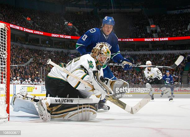 Raffi Torres of the Vancouver Canucks looks on as Kari Lehtonen of the Dallas Stars makes a save during their game at Rogers Arena on January 24,...