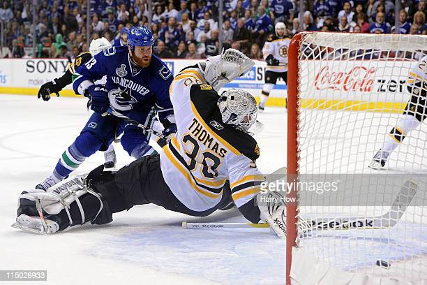 Raffi Torres of the Vancouver Canucks scores a goal late in the third period against Tim Thomas of the Boston Bruins during game one of the 2011 NHL...