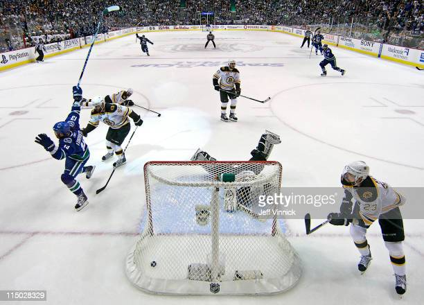 Raffi Torres of the Vancouver Canucks scores with 18 seconds left to go in the third period while Tim Thomas, Chris Kelly, Milan Lucic, Zdeno Chara...