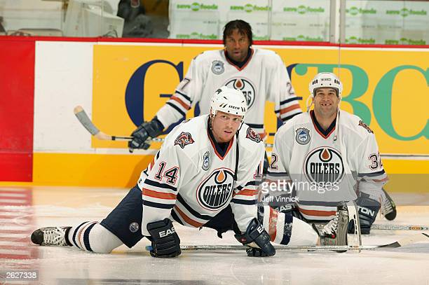 Raffi Torres, Scott Ferguson and Georges Laraque of the Edmonton Oilers stretch before the NHL game against the Vancouver Canucks on October 11, 2003...