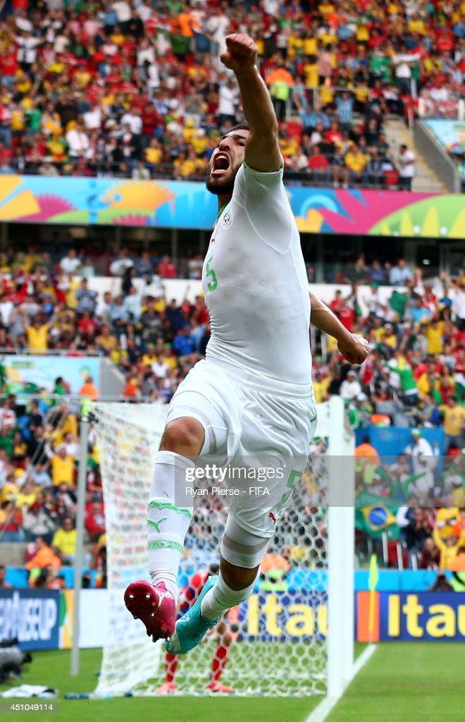 Rafik Halliche (C) of Algeria celebrates scoring his team's second goal during the 2014 FIFA World Cup Brazil Group H match between Korea Republic and Algeria at Estadio Beira-Rio on June 22, 2014 in Porto Alegre, Brazil.