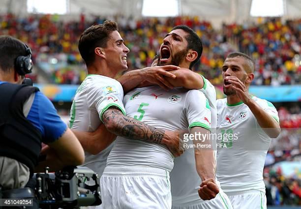 Rafik Halliche of Algeria celebrates scoring his team's second goal with his teammates Carl Medjani and Islam Slimani during the 2014 FIFA World Cup...