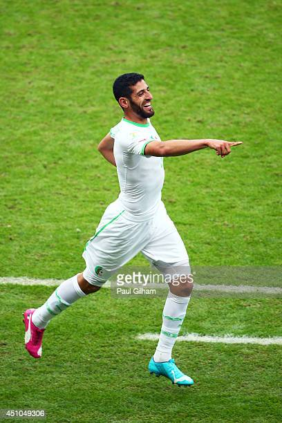 Rafik Halliche of Algeria celebrates scoring his team's second goal during the 2014 FIFA World Cup Brazil Group H match between South Korea and...