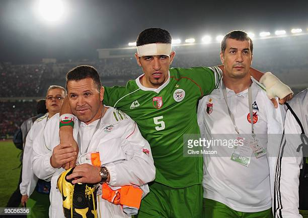 Rafik Halliche of Algeria is helped of the field after the FIFA2010 World Cup qualifying match between Egypt and Algeria at the Cairo International...