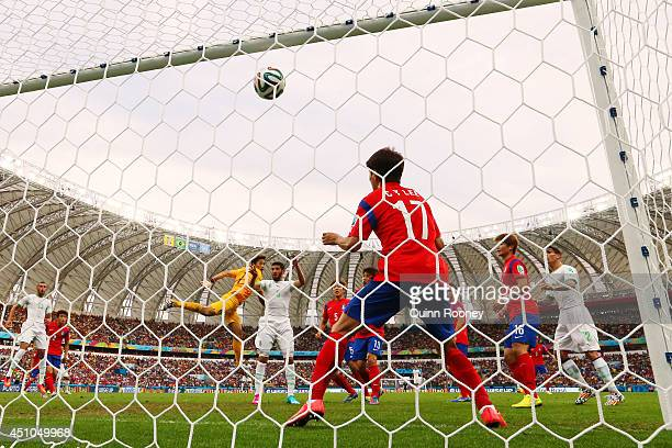 Rafik Halliche of Algeria scores his team's second goal on a header past goalkeeper Jung SungRyong and Lee ChungYong of South Korea during the 2014...