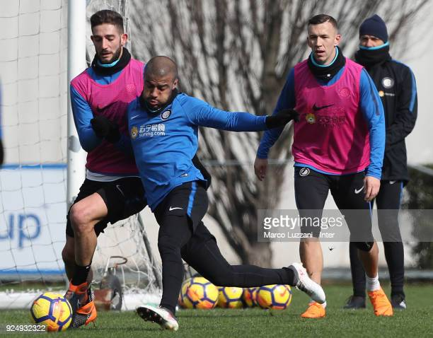 Rafinha Alcantara competes with Roberto Gagliardini during the FC Internazionale training session at the club's training ground Suning Training...