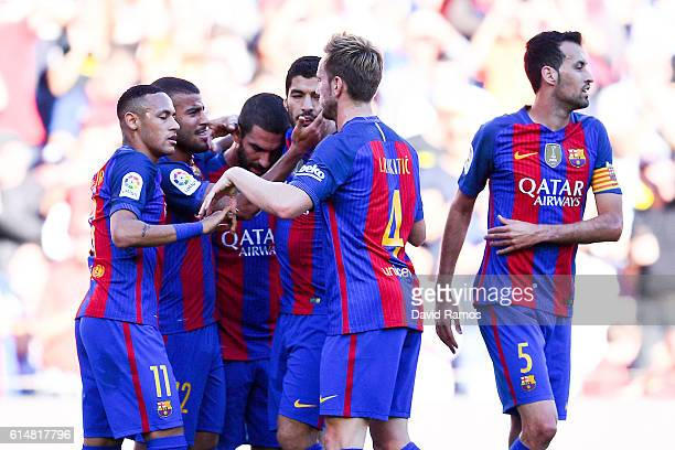 Rafinha Alcantara of FC Barcelona celebrates with his team mates after scoring his team's first goal during the La Liga match between FC Barcelona...