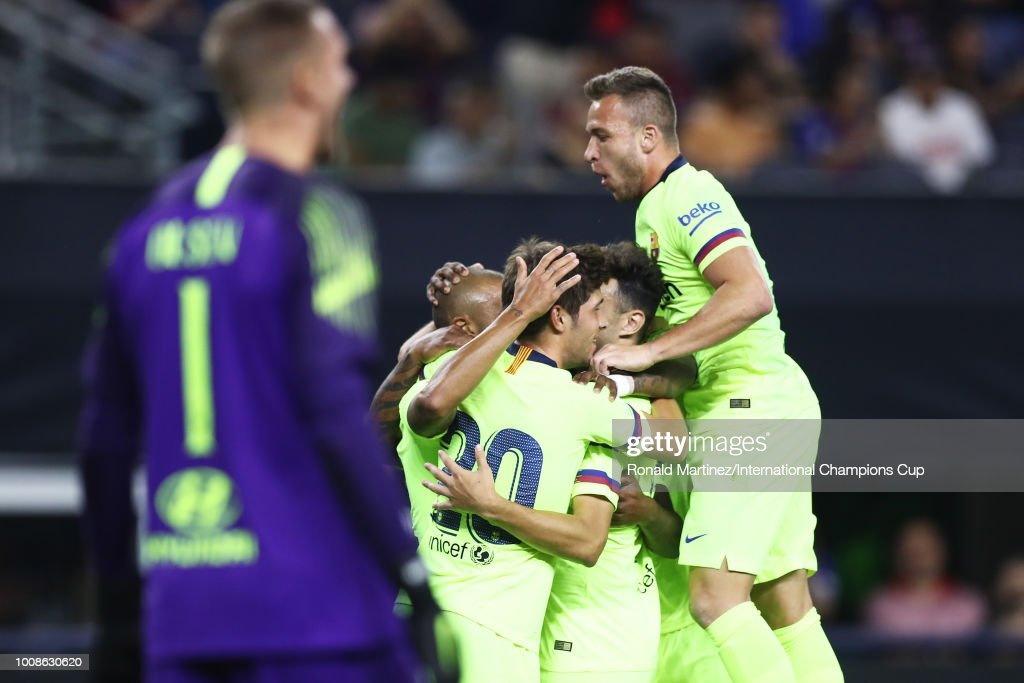 Rafinha Alcantara #12 of FC Barcelona celebrates with teammates after scoring against AS Roma during their International Champions Cup 2018 match at AT&T Stadium on July 31, 2018 in Arlington, Texas.