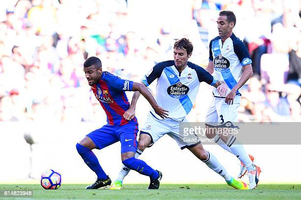 Rafinha Alcantara of FC Barcelona competes for the ball with Pedro Mosquera and Fernando Navarro of RC Deportivo La Coruna during the La Liga match...